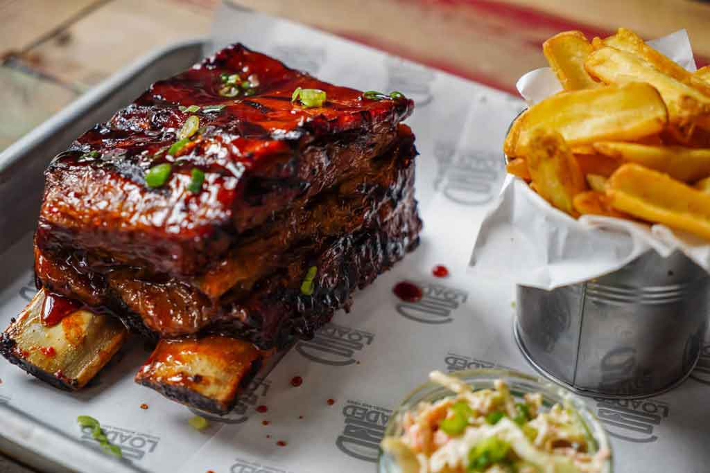 restaurant food photograph of bbq ribs and chips