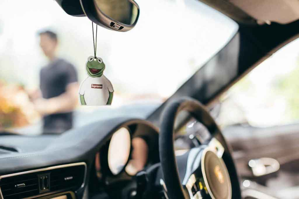 luxury brand photography of kermit the frog wearing white supreme top car freshener