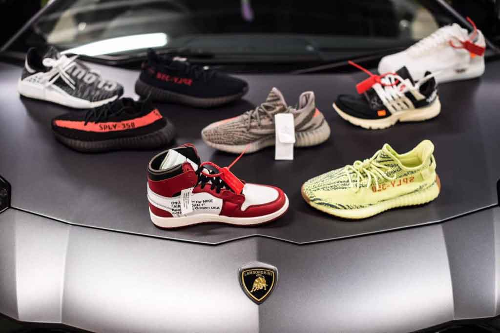 sports shoe photography in london. Luxury branded shoes on Lamborghini